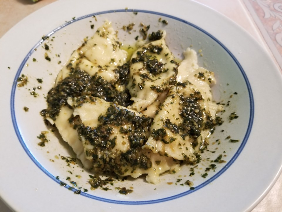 half moon pasta made from homemade pasta recipes tossed with pesto