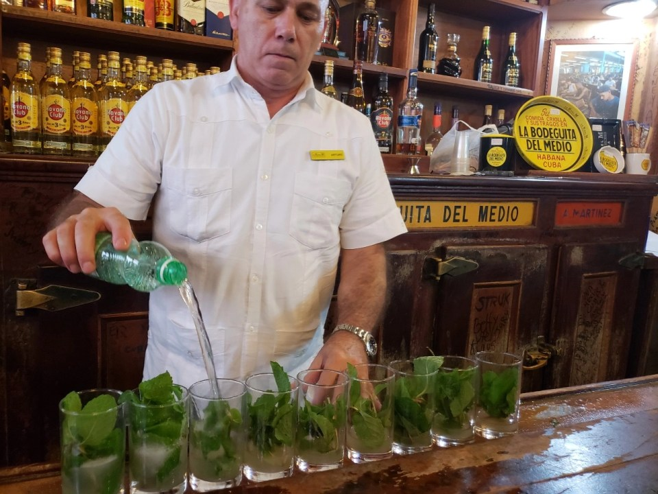 A bartender making mojitos at one of the speakeasys in Havana
