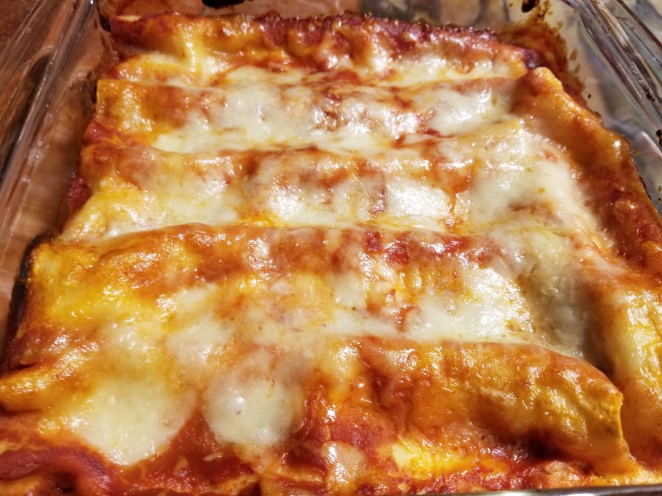 shows cooked cannelloni made with homemade pasta recipes