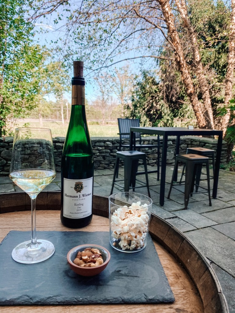 bottle of Riesling and snacks at a vineyard in the Finger Lakes region of New York