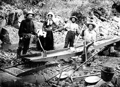 history travel back in time to the California Gold Rush, photo shows a family panning for gold
