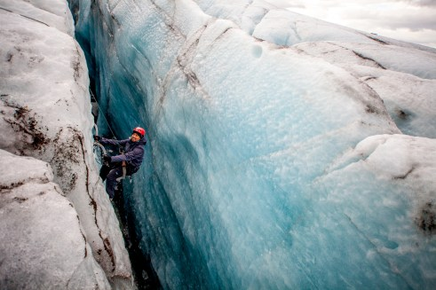 man Ice climbing in Iceland