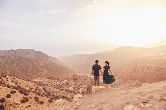 Couple standing overlooking a mountain and valley Dana Reserve