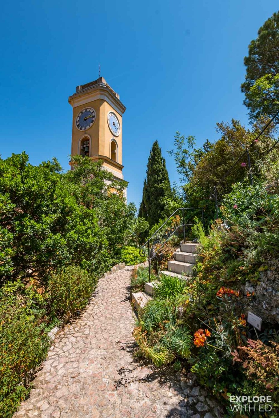Eze church bell tower and Mediterranean flower garden