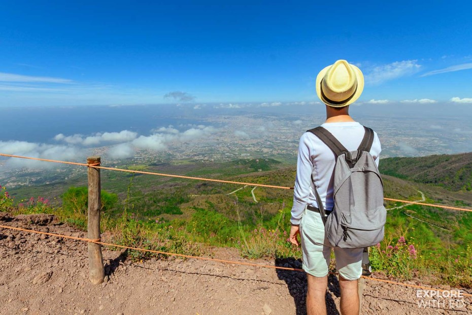 Travel blogger Explore With Ed hiking Mount Vesuvius and overlooking the view of Naples