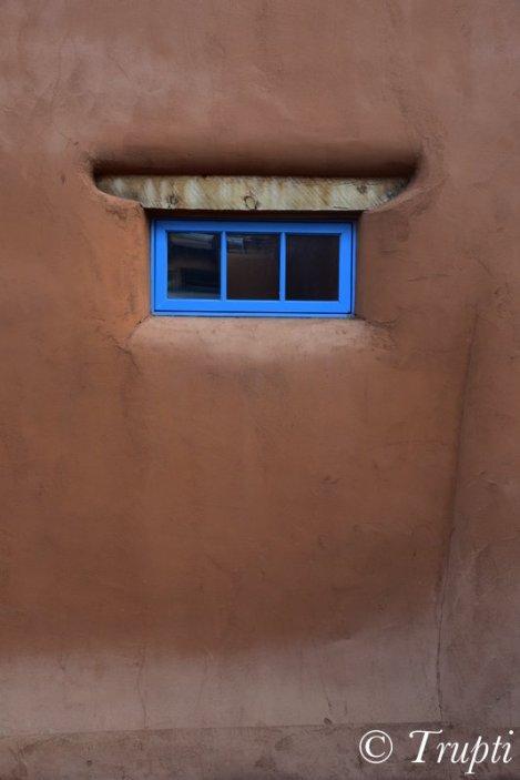 Adobe Wall and Blue Window in Santa Fe