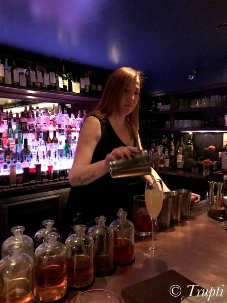Christiana pouring us a cocktail at The Office speakeasy in Chicago