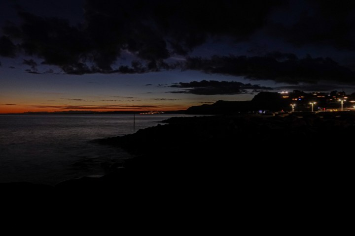 View of Lyme Regis at sunset in West Bay