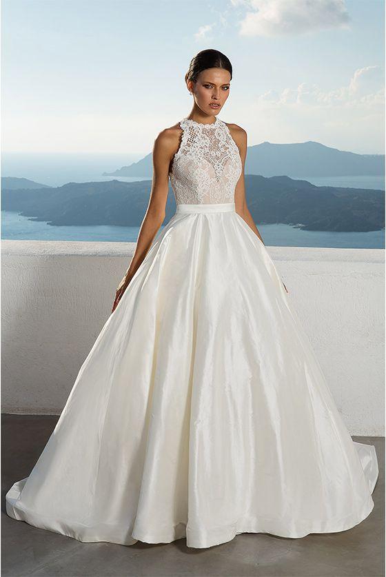 cc1202ab12 Justin Alexander debuted on the bridal fashion scene as T G Bridal in  Brooklyn