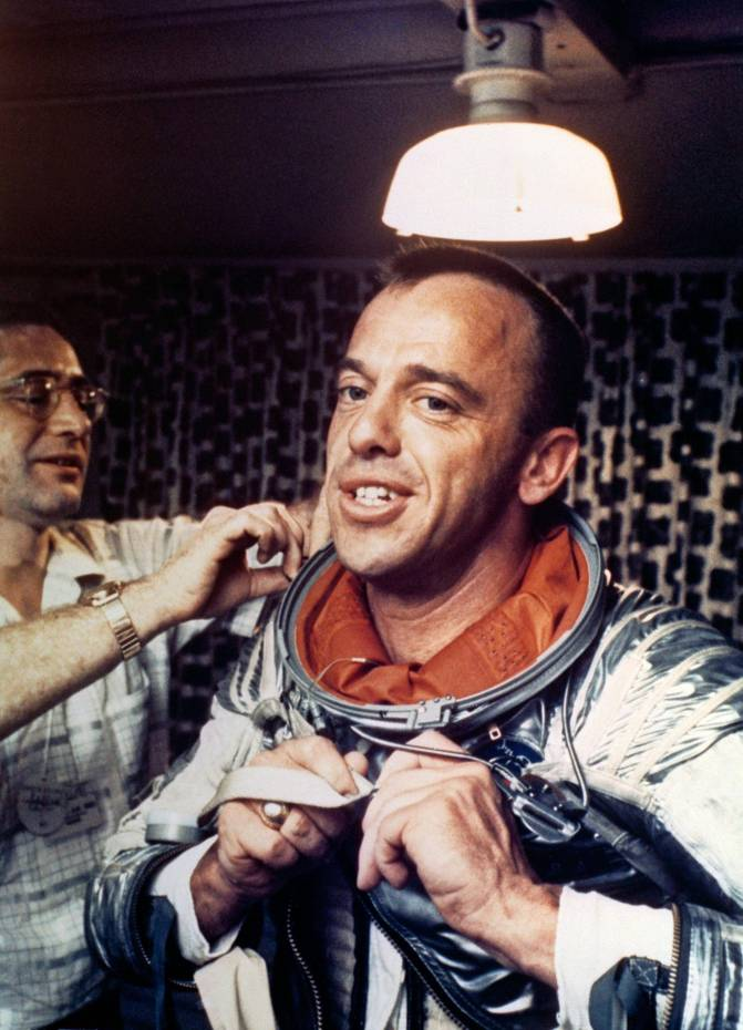 Alan Shepard, America's first man in space, puts on his Navy Mark IV spacesuit