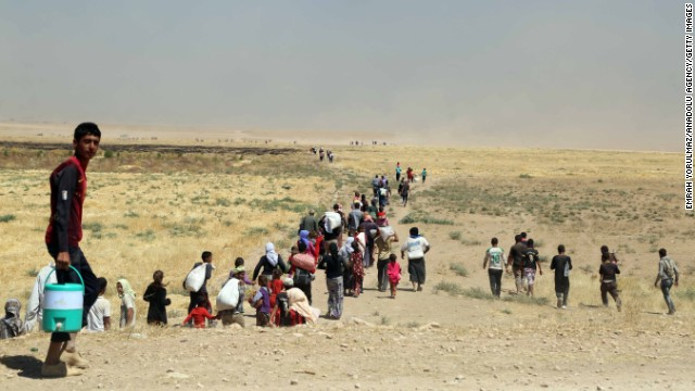 Thousands of Yezidis trapped on Sinjar Mountain as they tried to escape from ISIS forces, are evacuated by Kurdish Peshmerga forces and People's Protection Unit (YPG) in Mosul, Iraq, on August 9.
