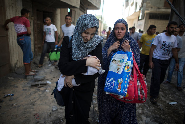 Palestinians left their home in the southern border town of Rafah on Friday to head for a safer location after Israeli airstrikes. Credit Wissam Nassar for The New York Times.