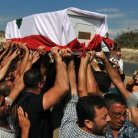 Lebanese mourners carry the coffin of Lebanese soldier Ali al-Sayyed draped in his national flag in the village of Qalamoun south of the northern Lebanese city of Tripoli during his funeral procession on September 3, 2014. (Photo: AFP - Ibrahim Chalhoub)