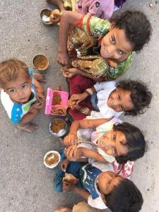 Robin Hood Army children eating food