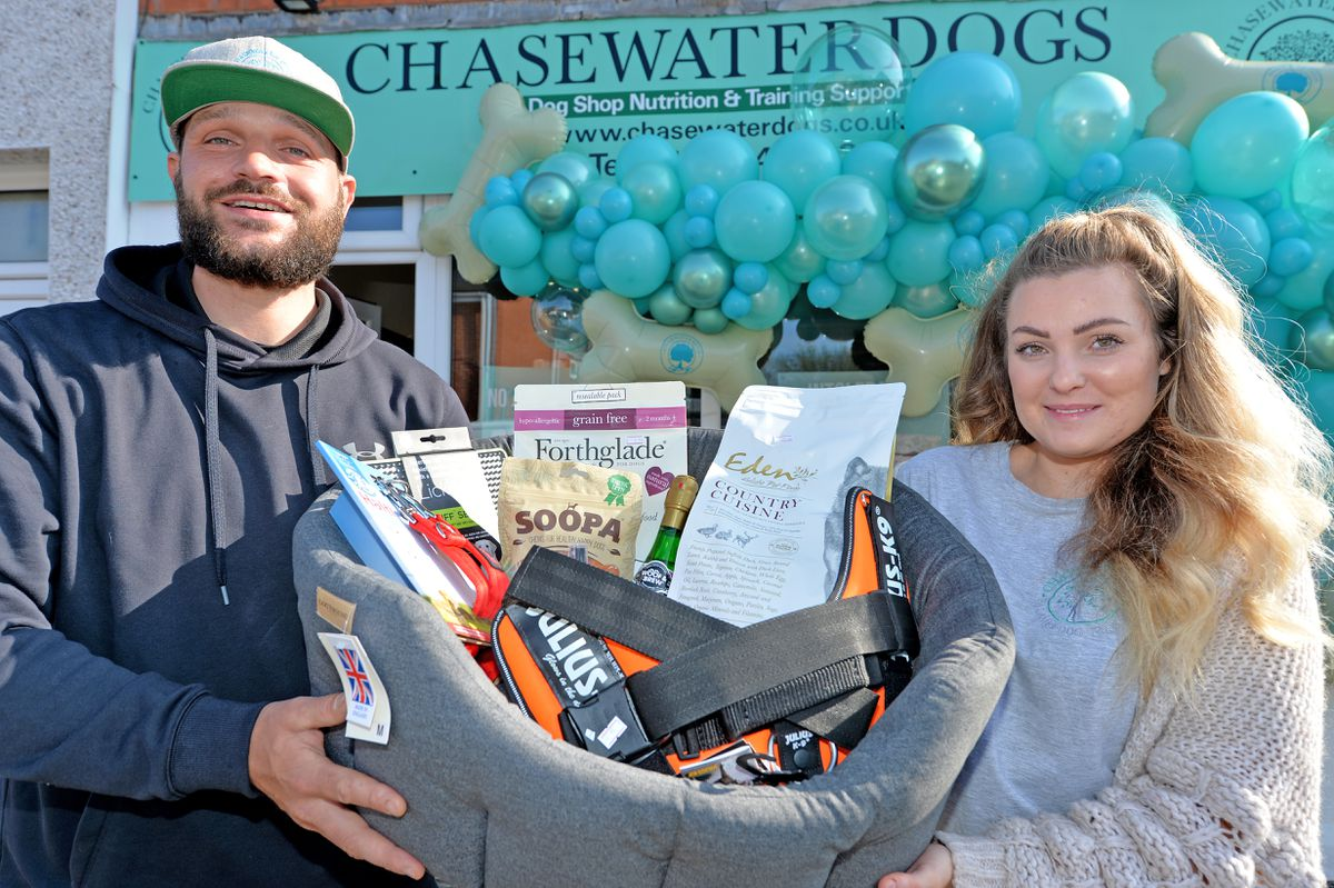 Stewart Cooper and Elyse Turner with their new business, the Chasewater Dogs Shop in Heath Hayes as it finally opens, following months of delay due to Covid
