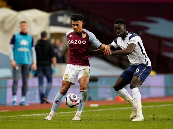 Aston Villa's Ollie Watkins (left) and Tottenham Hotspur's Davinson Sanchez (right) fight for the ball during a Premier League game in Villa Park, Birmingham.  Image Date: Sunday, March 21, 2021. PA Photo.  Check out the PA story of SOCCER Villa.  The photo should read: Tim Keeton / PA Wire.  RESTRICTIONS: EDITORIAL USES ONLY No use of unauthorized audio, video, data, match lists, club / league logos or