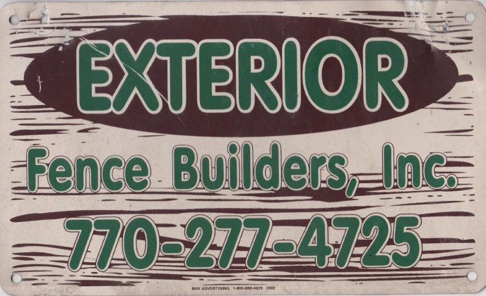 Exterior Fence Builders, Inc. Fence sign for 1999 to 2009. during this time were also operationing under the name of Keep on Fencing