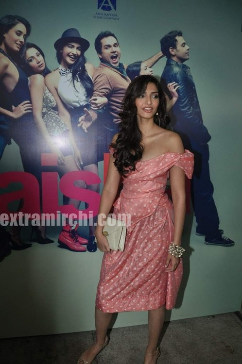 Sonam-Kapoor-with-Coral-voile-polka-dot-fitted-dress-from-Vivienne-Westwood-1.jpg