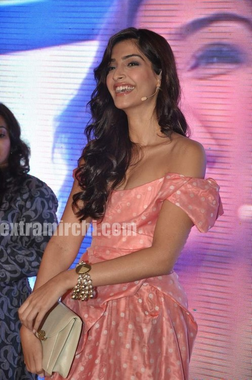 Sonam-Kapoor-with-Coral-voile-polka-dot-fitted-dress-from-Vivienne-Westwood-2.jpg