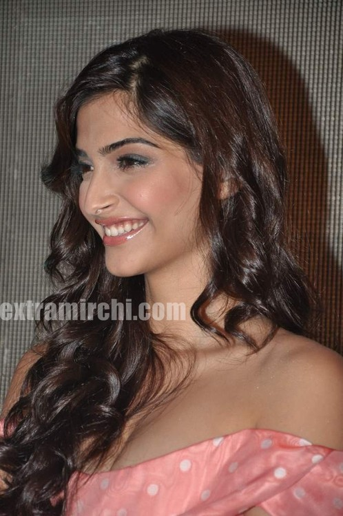 Sonam-Kapoor-with-Coral-voile-polka-dot-fitted-dress-from-Vivienne-Westwood-5.jpg