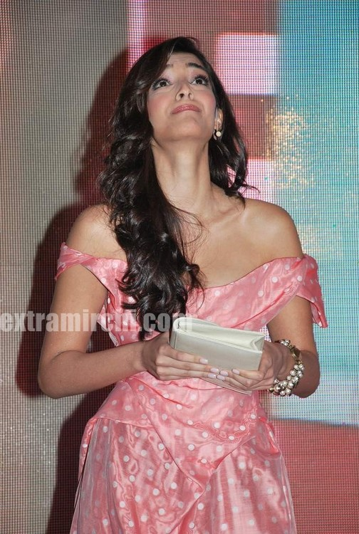 Sonam-Kapoor-with-Coral-voile-polka-dot-fitted-dress-from-Vivienne-Westwood-7.jpg