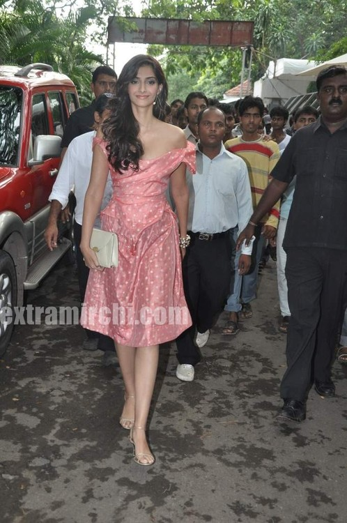 Sonam-Kapoor-with-Coral-voile-polka-dot-fitted-dress-from-Vivienne-Westwood.jpg