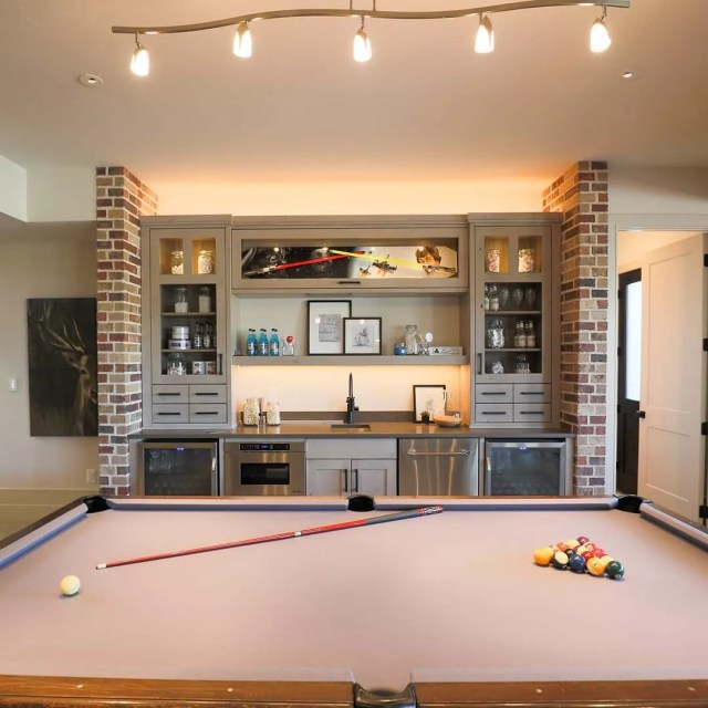 Basement with pool table. Photo by Instagram user @landforms_designs