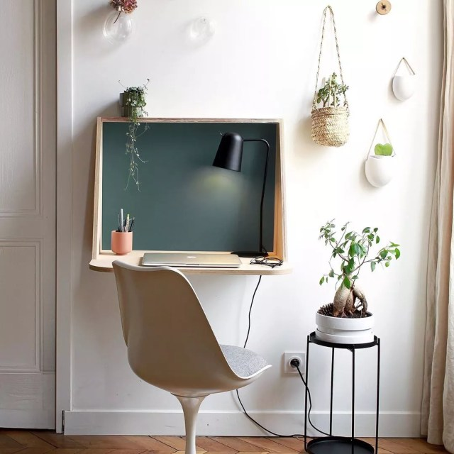 Fold-down desk with computer and chair. Photo by Instagram user @unique.mobilier