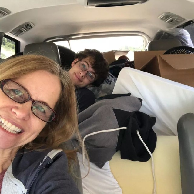 Mom and son in car with college belongings shoved in. Photo by Instagram user @ginibellawala
