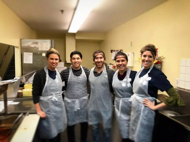 Volunteers with Aprons Working in a Soup Kitchen. Photo by Instagram user @betterworks