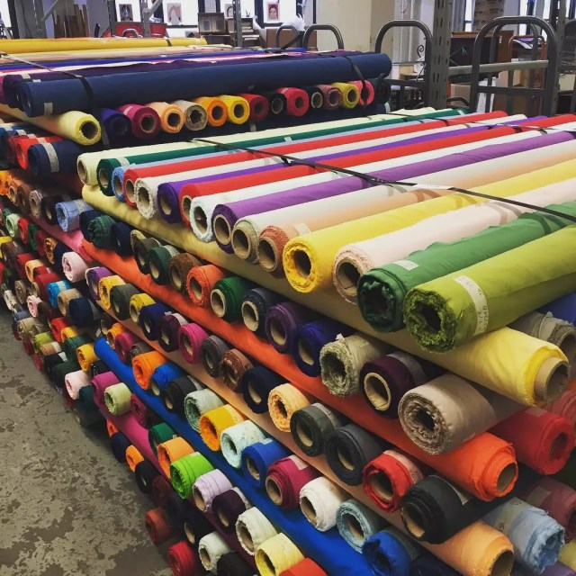 Rolls of Many Different Colored Fabrics in a Warehouse. Photo by Instagram user @materialsforthearts