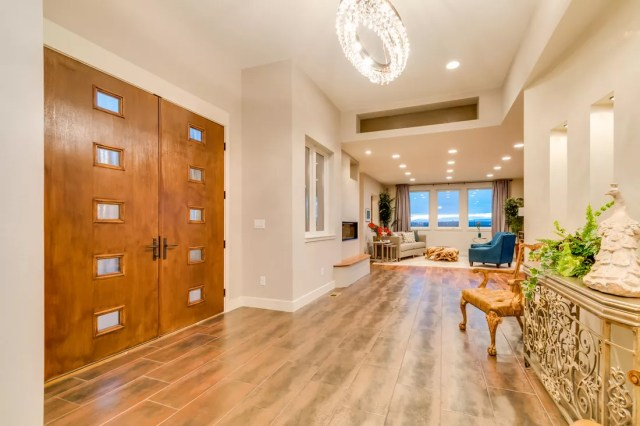 Professional real estate photo showing entry and living room of home
