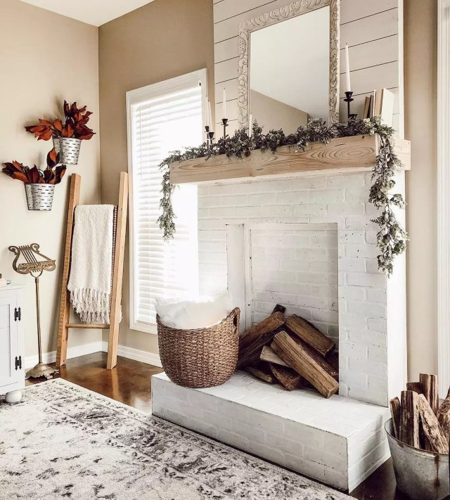 White fireplace and neutral beige walls. Photo by Instagram user @kristenfortier