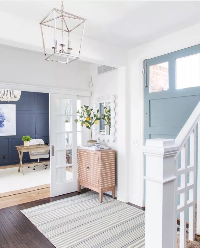 Entryway with white and light blue design. Photo by Instagram user @kathykuohome