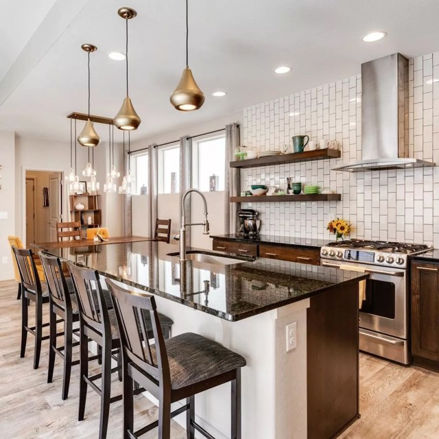 Modern kitchen staged for home showing. Photo by Instagram user @yellowumbrellaimaging