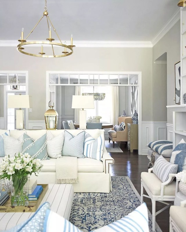 Blue and cream living room, staged home for sale. Photo by Instagram user @citrineliving