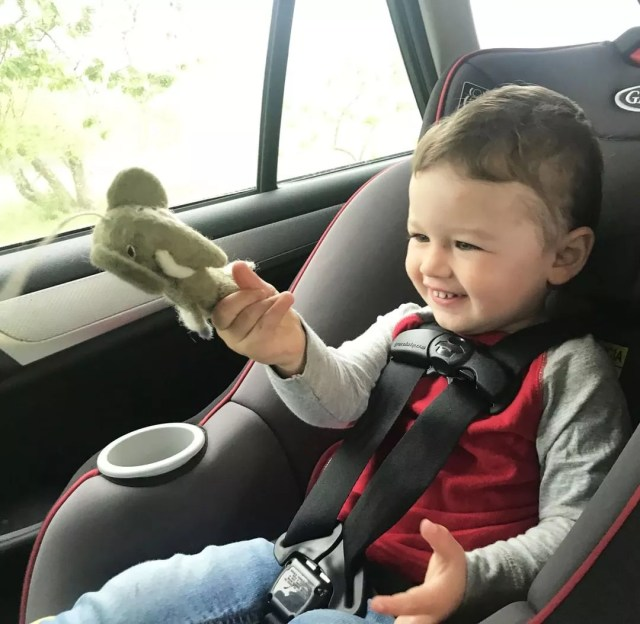 Little boy playing with toy in car. Photo by Instagram user @bellalunatoys