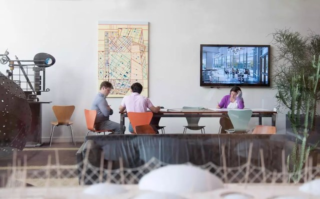 People Working at a Conference Table. Photo by Instagram user @overlandpartners