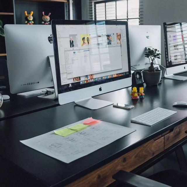 Clean Desk Space with Computer Turned On. Photo by Instagram user @macsetups