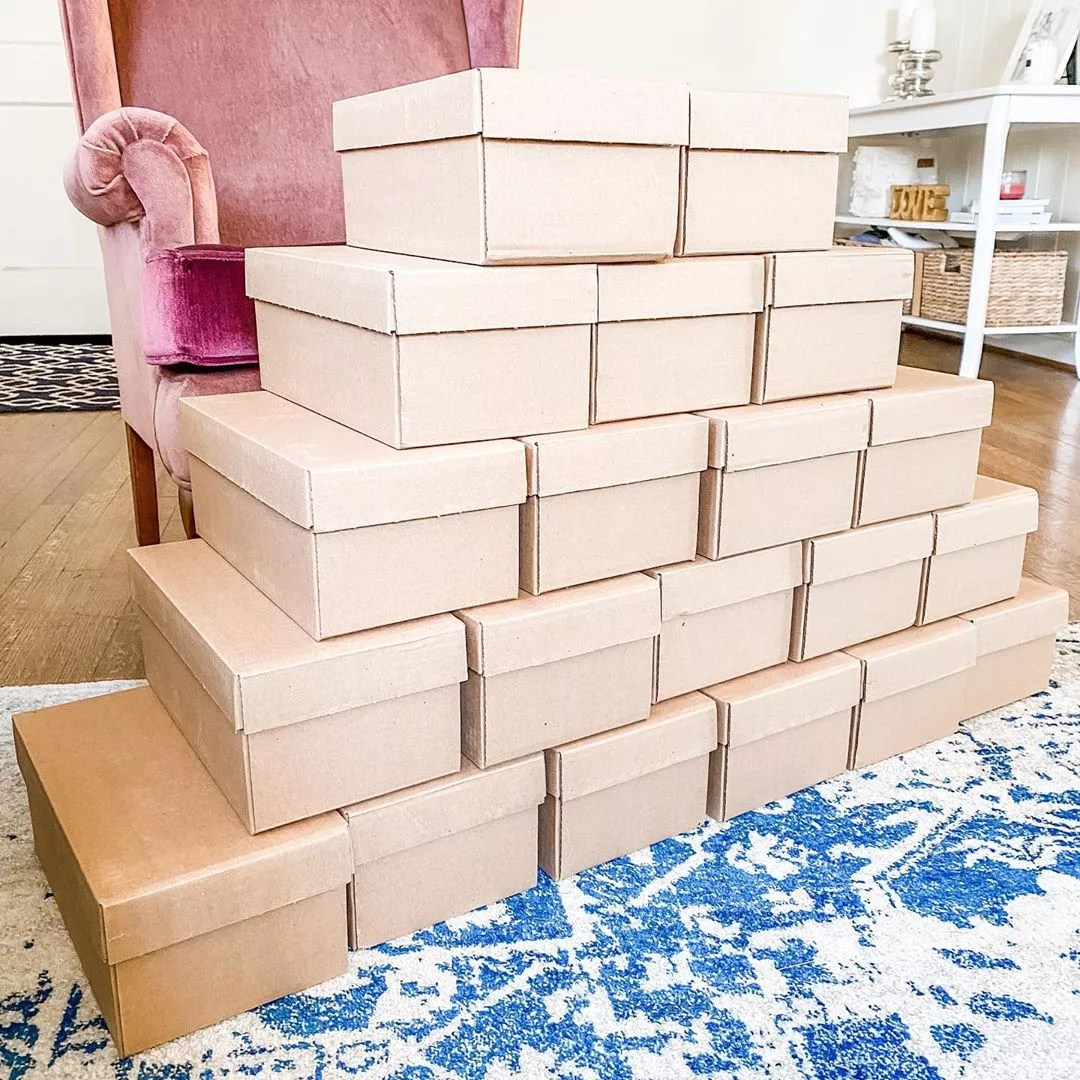 Stack of boxes for small business. Photo by Instagram user @thesinginglittlebirdshop