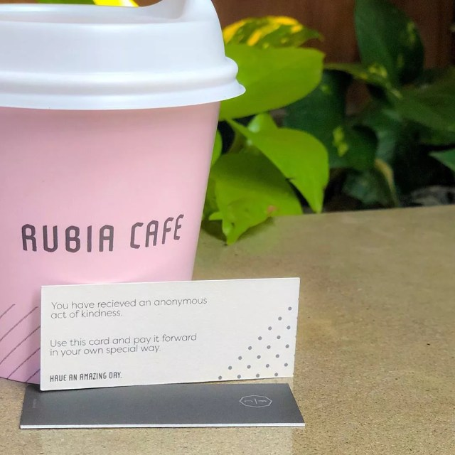 Pink to-go cup of coffee. Photo by Instagram user @rubiacafe