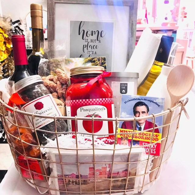 Wire basket of food and cards. Photo by Instagram user @paperheartaffairs_