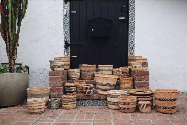 Woven basket on porch stairs. Photo by Instagram user @ravenandlily
