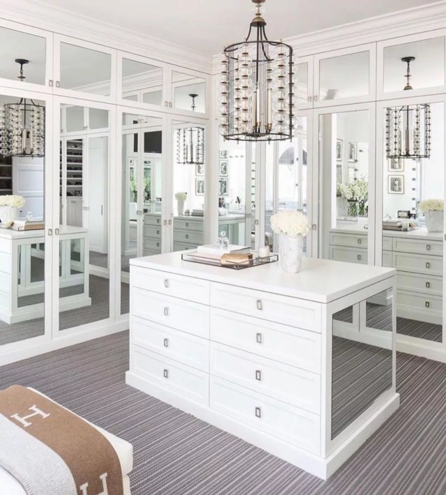 White walk-in closet with mirrors. Photo by Instagram user @nyametherealtor