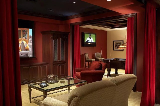 Home theater space separated by curtains with pool table in adjoining room photo by Instagram user @phyllisharbinger