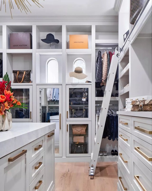Walk-in closet with rolling ladder. Photo by Instagram user @havendesignandconstruction