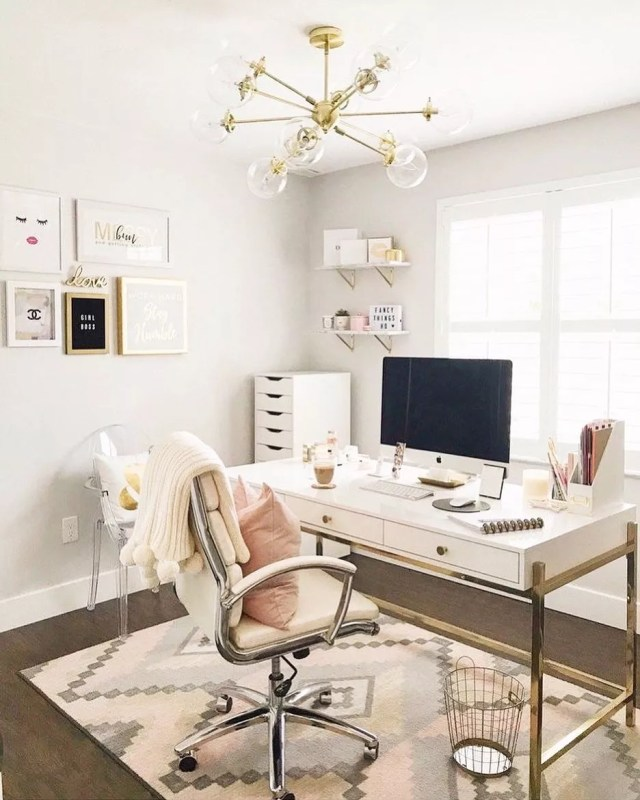 Modern gold themed home office. Photo by Instagram user @herdesk.co