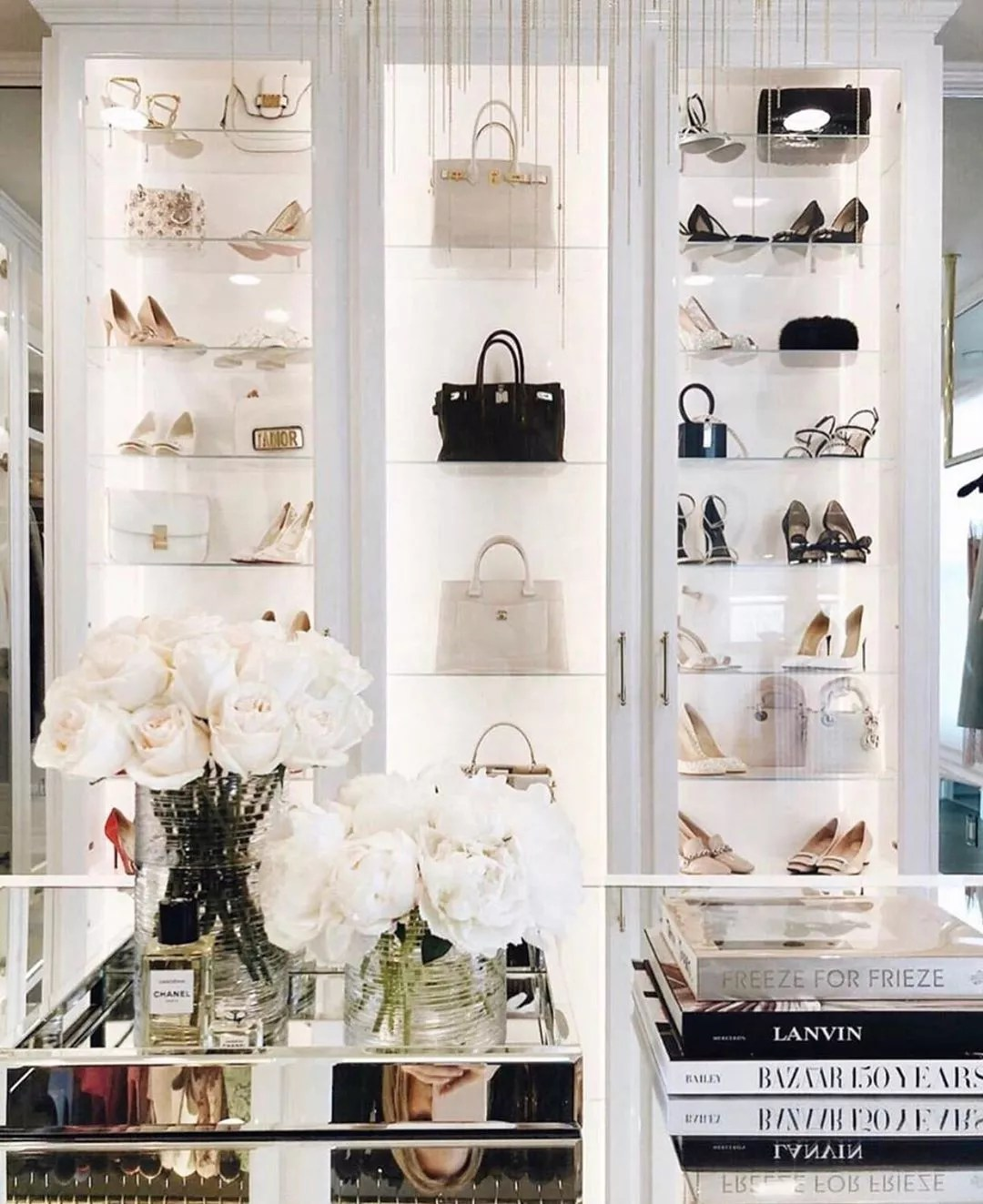 Shoes and purses in luxury closet. Photo by Instagram user @laclosetdesign