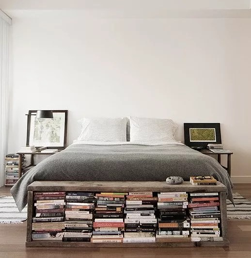 Books Stored in Footboard at End of Bed. Photo by Instagram user @goodhomesmagazine