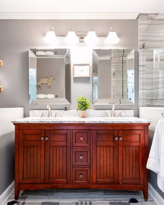 Clean Gray Bathroom with His and Hers Sinks. Photo by Instagram user @title1manager